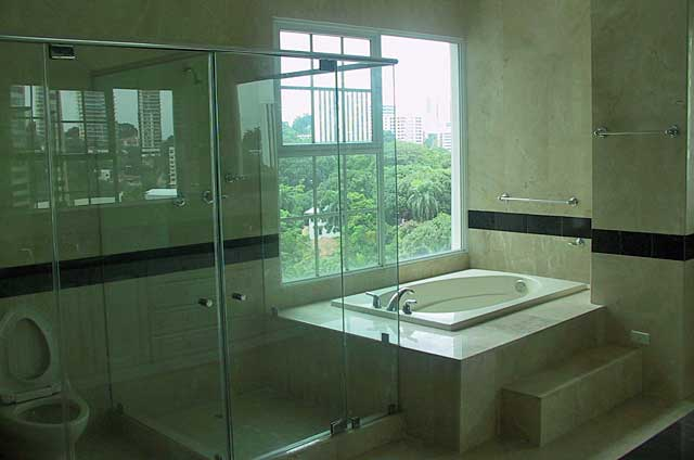 Bathroom Photo Example - luxurious bathroom with sand stone colored tiles and beige bath top