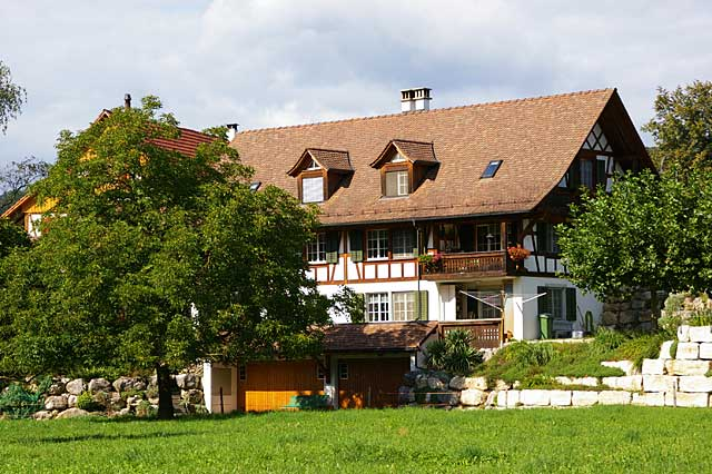 Photo of a typical farm house in Switzerland in the area around Zurich