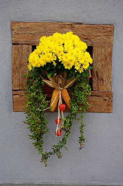 Example decor idea on a traditional old country home with a simple but very effective and beautiful flower decoration in a small window