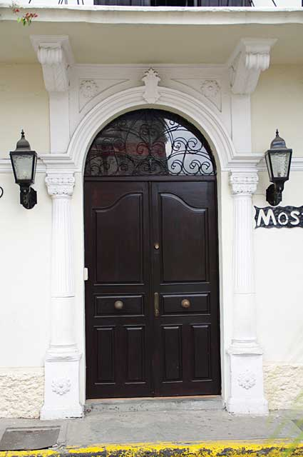 Photo Example of a beautifully old colonial renovated door that maintains its old dark wood finish