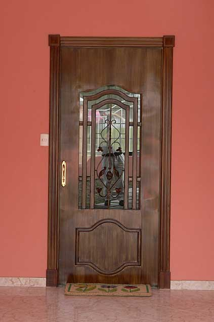 Photo example of a decorative metal door painted in brown color with wood imitation effects