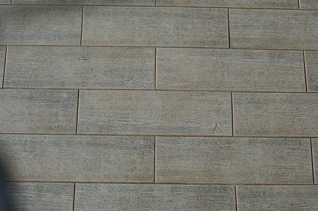 Example of a rustic wood imitation floor tile style, seen this one on a large terrace in a hotel