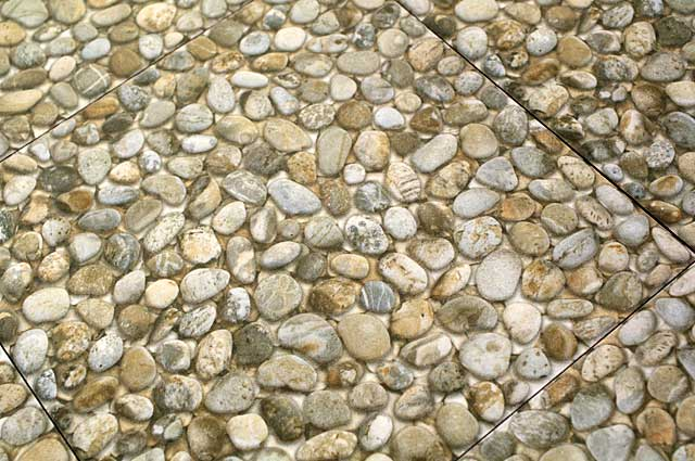 Photo Example small river stone covered floor tiles, most used as decorative elements and often in exterior spaces