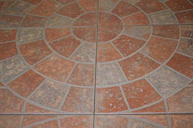 Photo example of a floor tile with a circular design element ideal for outdoor and terrace floors