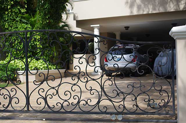 Photo example of a black metal gate in front of a city home