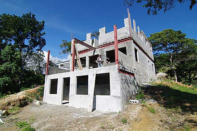 Example image of 3 story mountain country house under construction