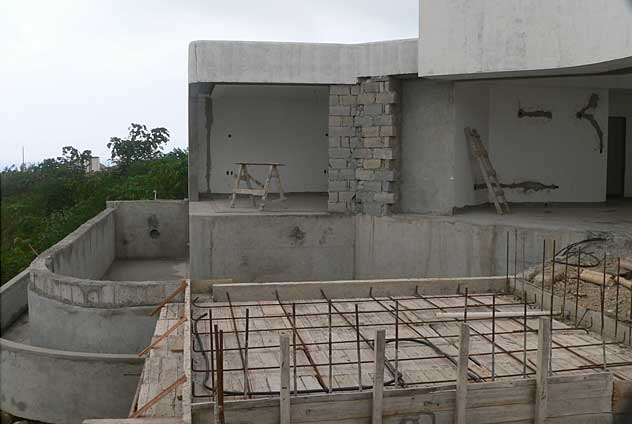 Example photo of a modern country house under construction, note in the front they build an infinity pool