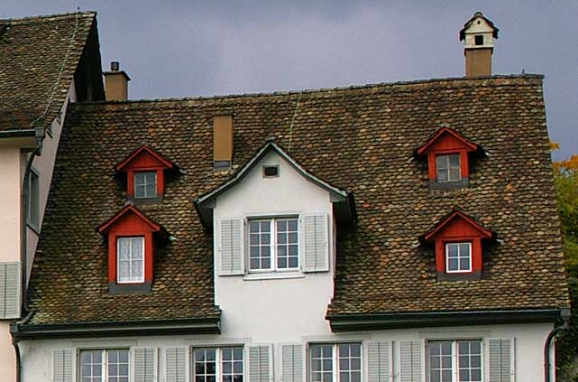 Example of a typical old townhouse in Europe with a high roof