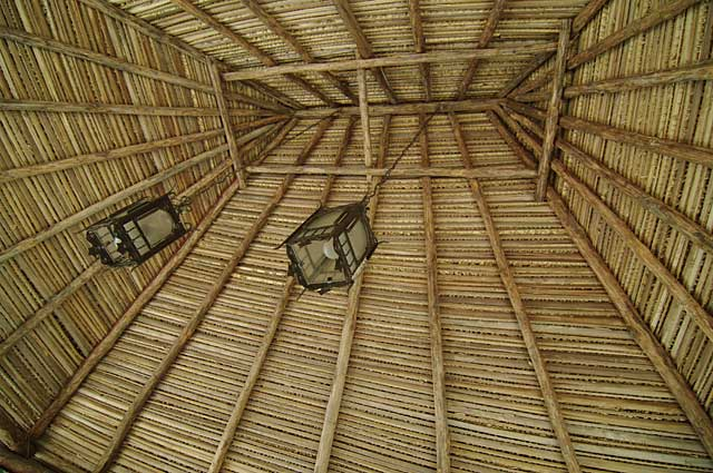 Example roof made of natural wood and covered with palm leaves on a beach hut