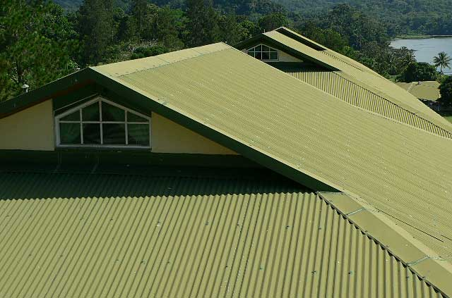 Example photo of a tropical resort hotel covered with green with zinc roofing material.
