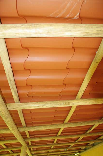 Example picture of the underside of a terrace roof on a country house with rustic tree beams