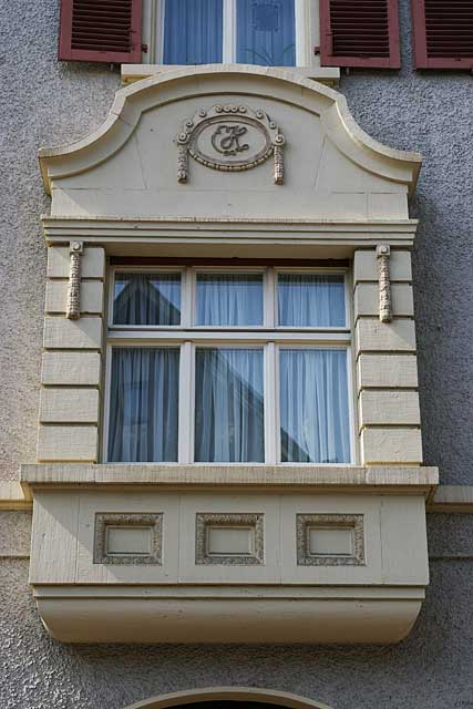 Photo example of a classic window in a city house, most windows in Switzerland have double glass insulation for better energy efficiency