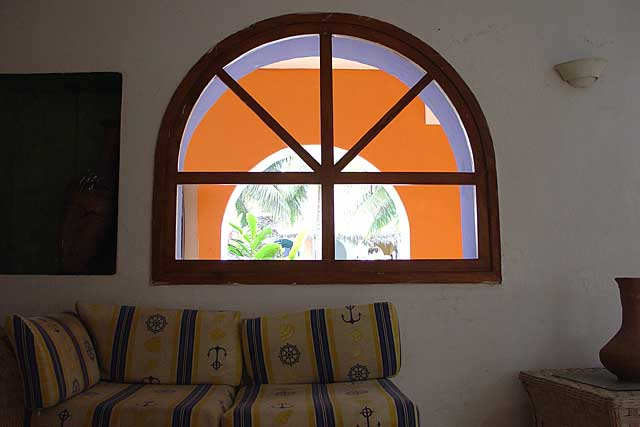 Photo of a simple but great design of a window with great color effects, here seen from the inside of the house