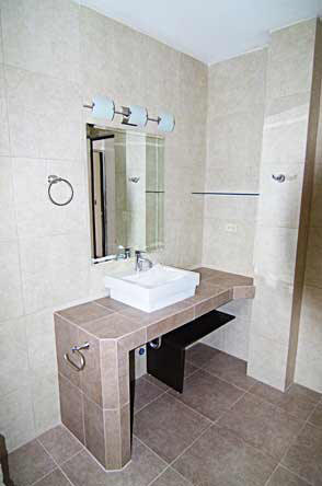 Bathroom vanities with concrete and covered with ceramic tiles
