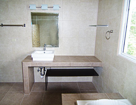 Building of bathroom vanities with concrete and covered with ceramic tiles